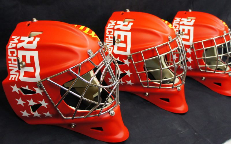 Аэрография «Matte Red Machine» на трёх вратарских шлемах
